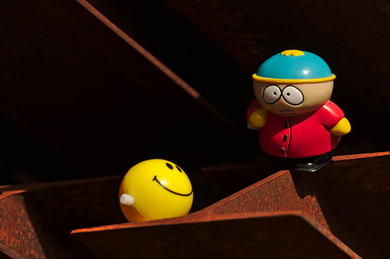 On The Railroad Best Friends Challenge Close-up Eric Eric Cartman Extreme Light Figurines  Focus On Foreground Iron Light And Shadow Low Angle View My Point Of View Nikon Red Rusty Rusty Railing See The World Through My Eyes Smily Southpark Still Life Talking Photos Telling Stories Toy Adventures Toy Story Yellow