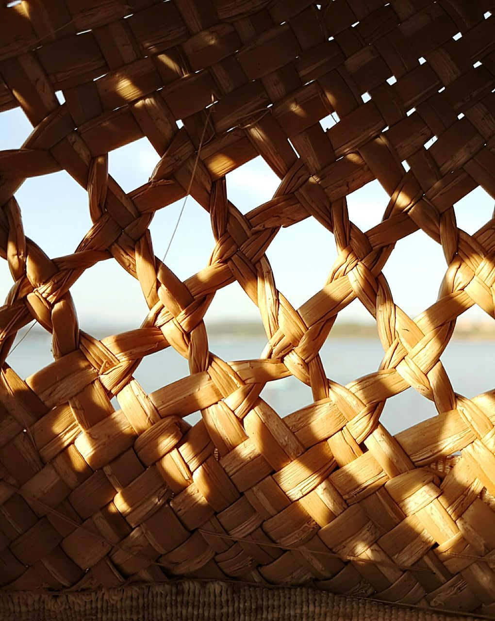 low angle view, basket, window, sky, no people, pattern, day, architecture, indoors, close-up