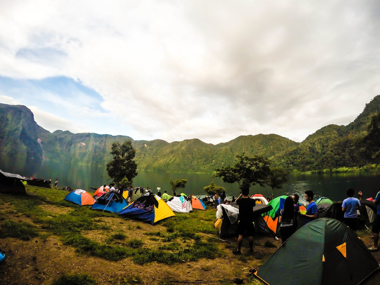 Woke up to this beautiful scene. <3 Beauty In Nature Camping Cloud - Sky Day Grass Green Color Lake View Landscape Mirror Lake Mountain Nature Outdoors People Relaxation Scenics Sky Summer Togetherness Travel Destinations Tree Trekking
