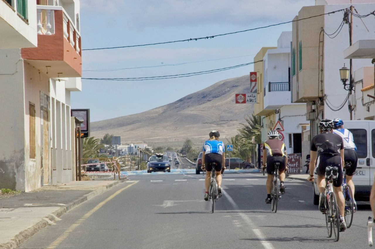 Road / Volcanic rock. Fuertaventura. Juxtaposition Volcanoe Road Cyclists Cycle Racing Racing Composition Unfinished Summer El Cotillo Bicycle Cycling Road Sports Clothing Racing Bicycle Sky Mountains Desert Infrastructure Architecture Spandex Contrast Contrast Of Nature & Humanity Contrast Nature-urban Nature And Architecture
