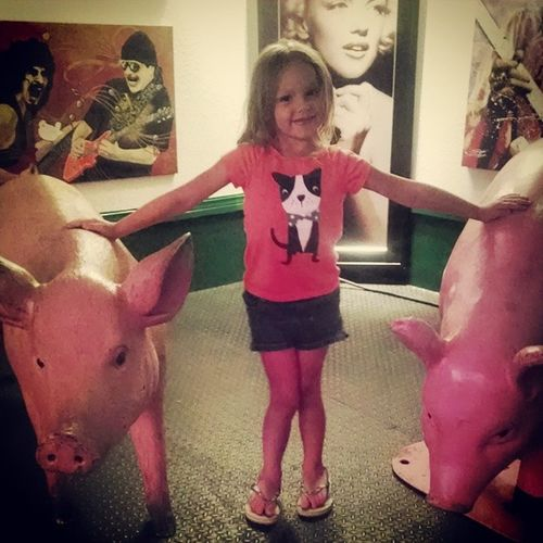 She wanted her picture taken with the giant pigs on the stage. Who am I to tell a diva no? Adventure Buddies
