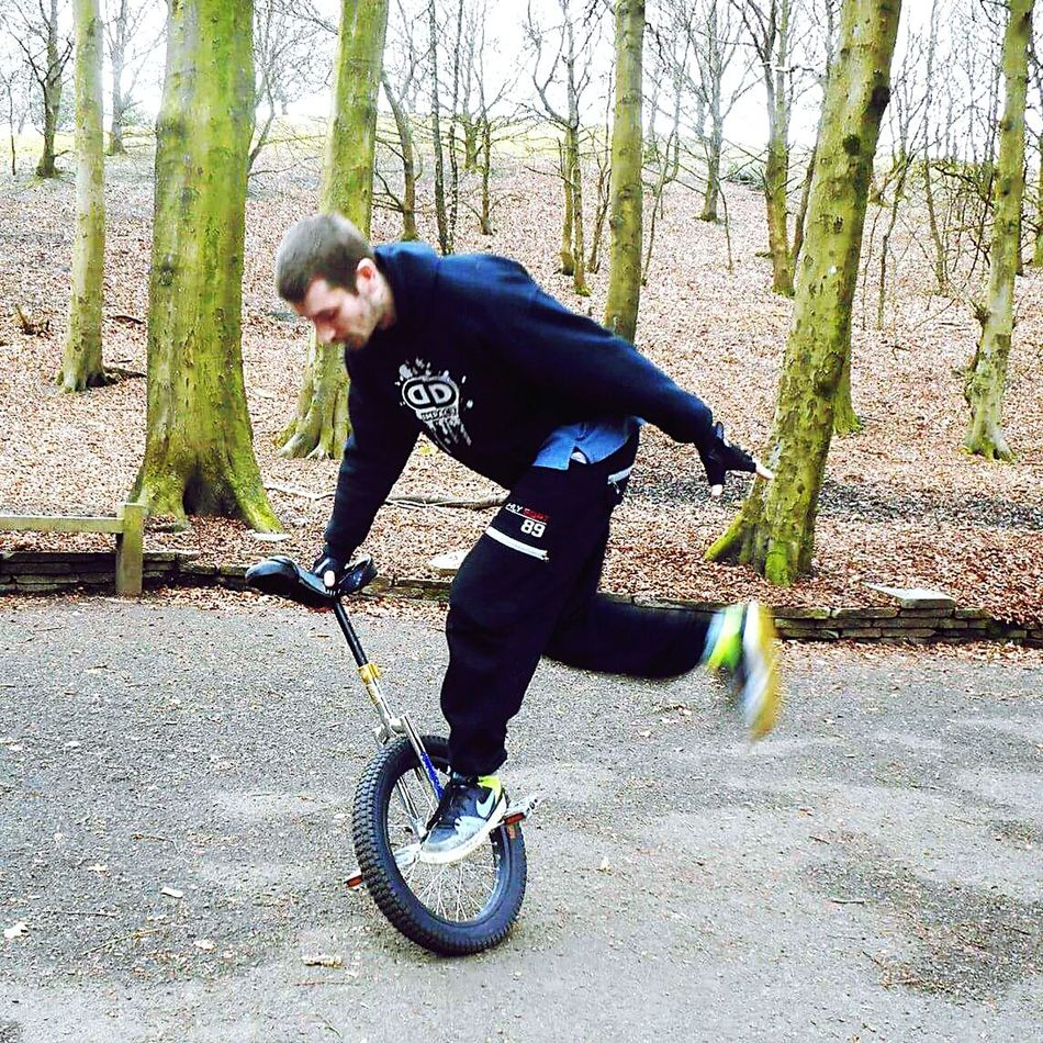 A Unicyclist (myself) doing tricks in boggart hole clough, Moston, Manchester Unicycle Unicycle Tricks Manchester Tandlehill Park Celebrate Your RideSummer Time  Smiley Face Jake 0161 Sport Extreme Sports Extreme Unicycling Alternative Fitness
