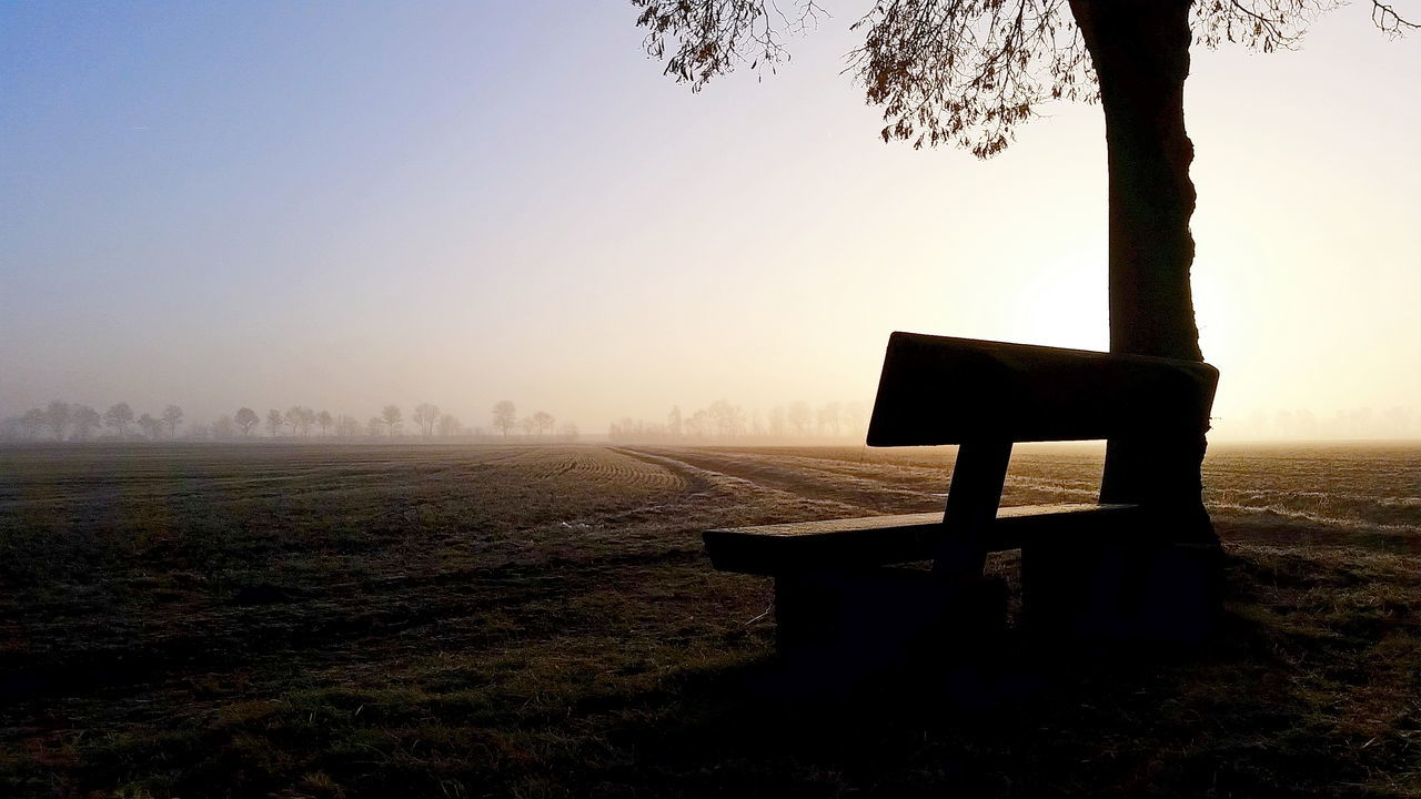 Bench Against Sky At Sunset