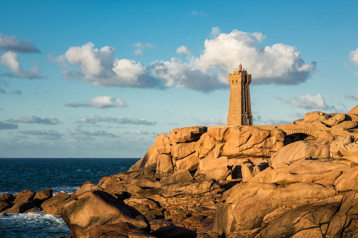 Atlantic Ocean coast near Ploumanac'h in Brittany, France. Architecture Atlantic Ocean Brittany Clouds And Sky Coast Day France Holiday Jounieh Landmark Landscape Lighthouse Nature Outdoors Ploumanac'h Rocks Sea Shore Sky Sky And Clouds Stones Tourism Travel Vacation Water