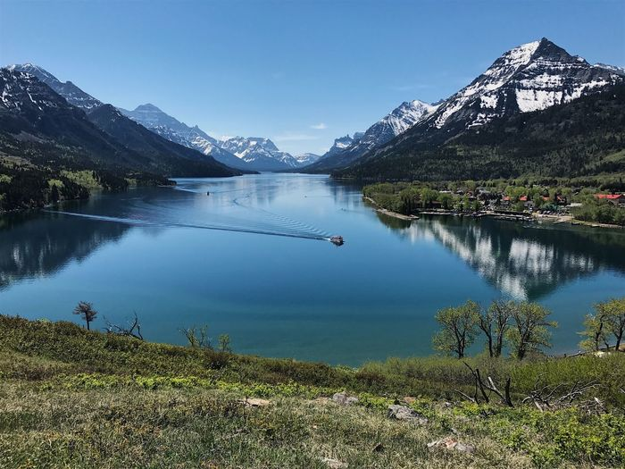 Waterton views. Mountain Water Lake Nature Scenics Tranquil Scene Beauty In Nature Mountain Range Blue Tranquility Reflection Day Outdoors No People Clear Sky Sky The Great Outdoors - 2017 EyeEm Awards