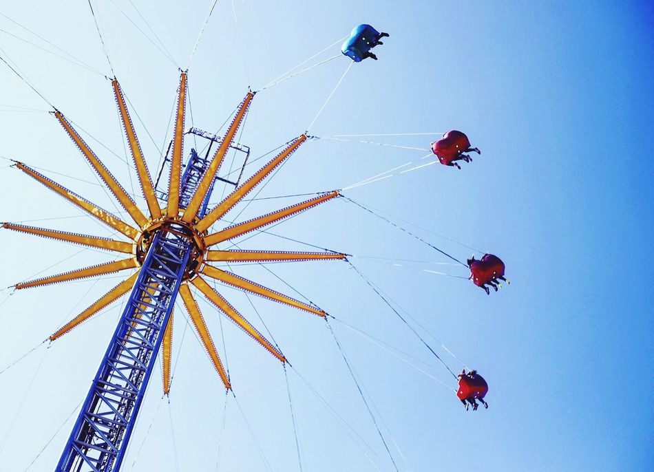Go another around Low Angle View Arts Culture And Entertainment Clear Sky Leisure Activity Real People Flying Lifestyles Sky Amusement Park Day Outdoors Chain Swing Ride Men One Person