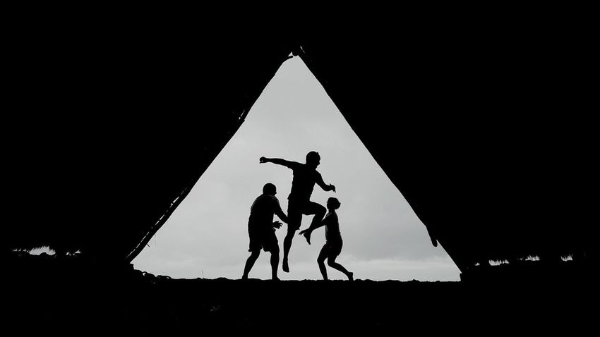 Silhouettes Jump Playing In The Rain