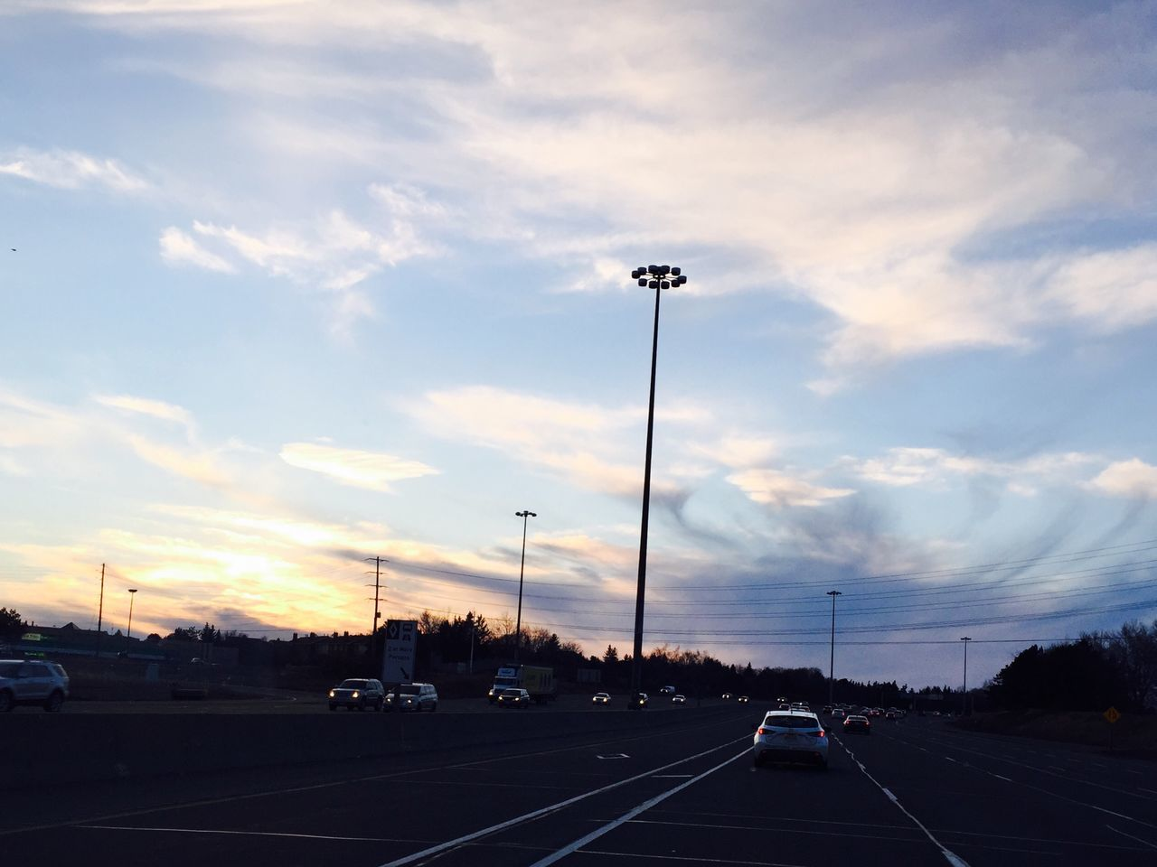 Silhouette Floodlight On Highway During Sunset
