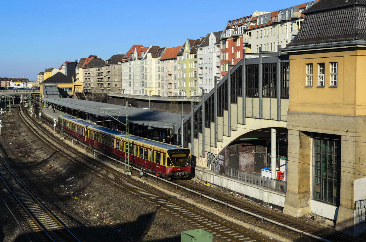Commuter train - S-Bahn - leaving station in Berlin, Germany Architecture Berlin Building Exterior Built Structure City Color Image Commuter Train Day Departure Germany Horizontal No People Outdoors Rail Transportation S-bahn Sky Sun