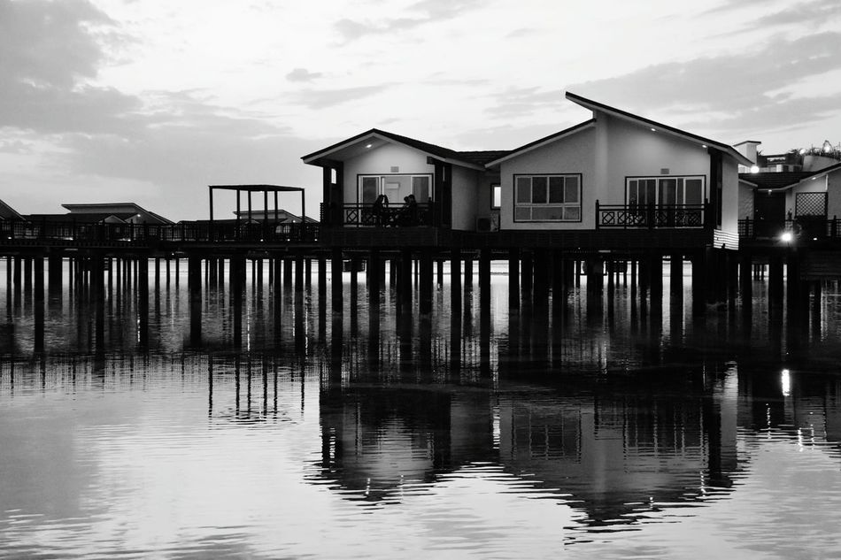 Blackandwhite Black White Living On The Ocean Monochrome Monochrome Photography Reflection Water Sunset Dusk Built Structure Seascape Photography Architecture Sea View Reflection Photography Nightphotography Darkness And Light On The Sea Black And White Outdoors Architecture And Nature Reflections In The Water Sea Floating Rooms in Iran Welcome To Black The Secret Spaces