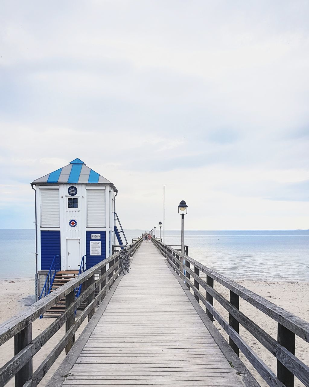 sea, water, horizon over water, pier, sky, beach, railing, wood - material, tranquil scene, nature, jetty, scenics, outdoors, day, no people, tranquility, cloud - sky, beauty in nature, wood paneling, sand, built structure