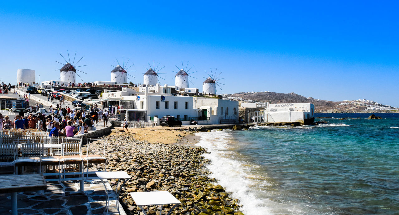 Mykonos,Greece Windmills Architecture Beach Beauty In Nature Blue Building Exterior Built Structure Clear Sky Day Go-west-photography.com Greece Kyklades Kyklades Islands Mykonos Nature Nautical Vessel Outdoors Sea Sky Travel Destinations Vacations Water