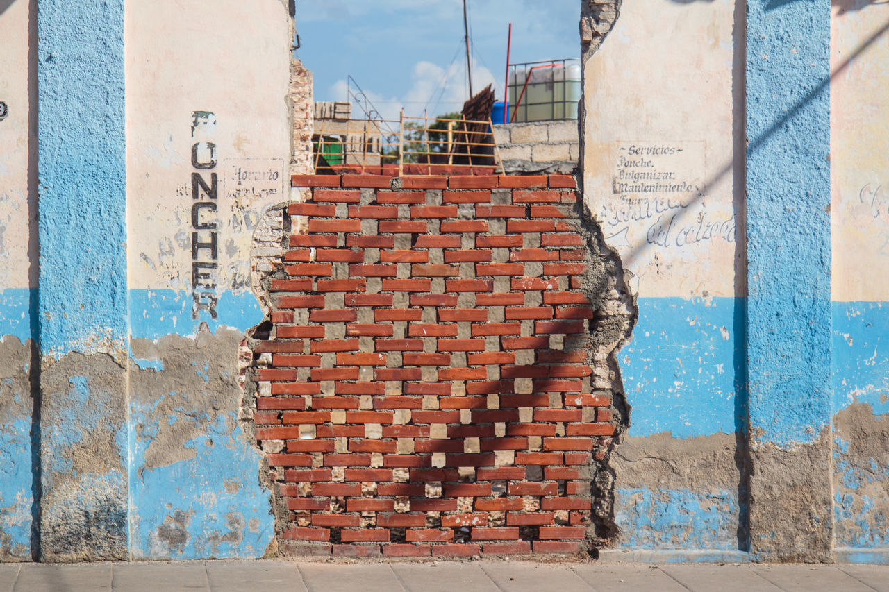Architecture Blue Brick Wall Brick Wall In Cuba Building Building Exterior Built Structure City Cloud Cuba Day Mejunje Multi Colored No People Outdoors Residential Building Santa Clara Sky Sunny Wall