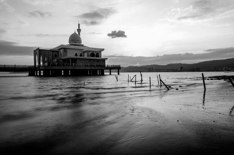 The shoreline Architecture Black & White Coastline Architecture Black And White Blackandwhite Bnw Bnw_collection Building Building Exterior Built Structure Floating Mosque Mosque No People Outdoors Shoreline Water Waterfront