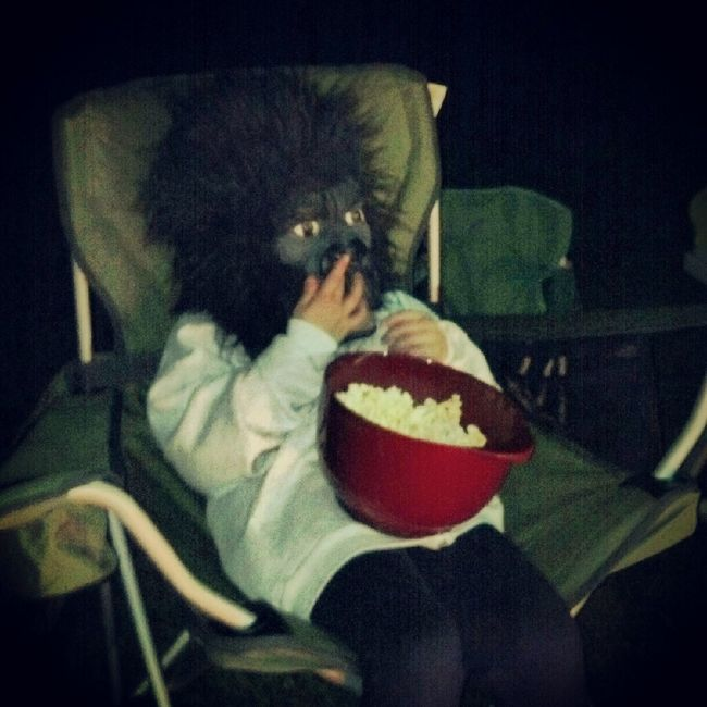 lil sasquatch eating popcorn by the fire