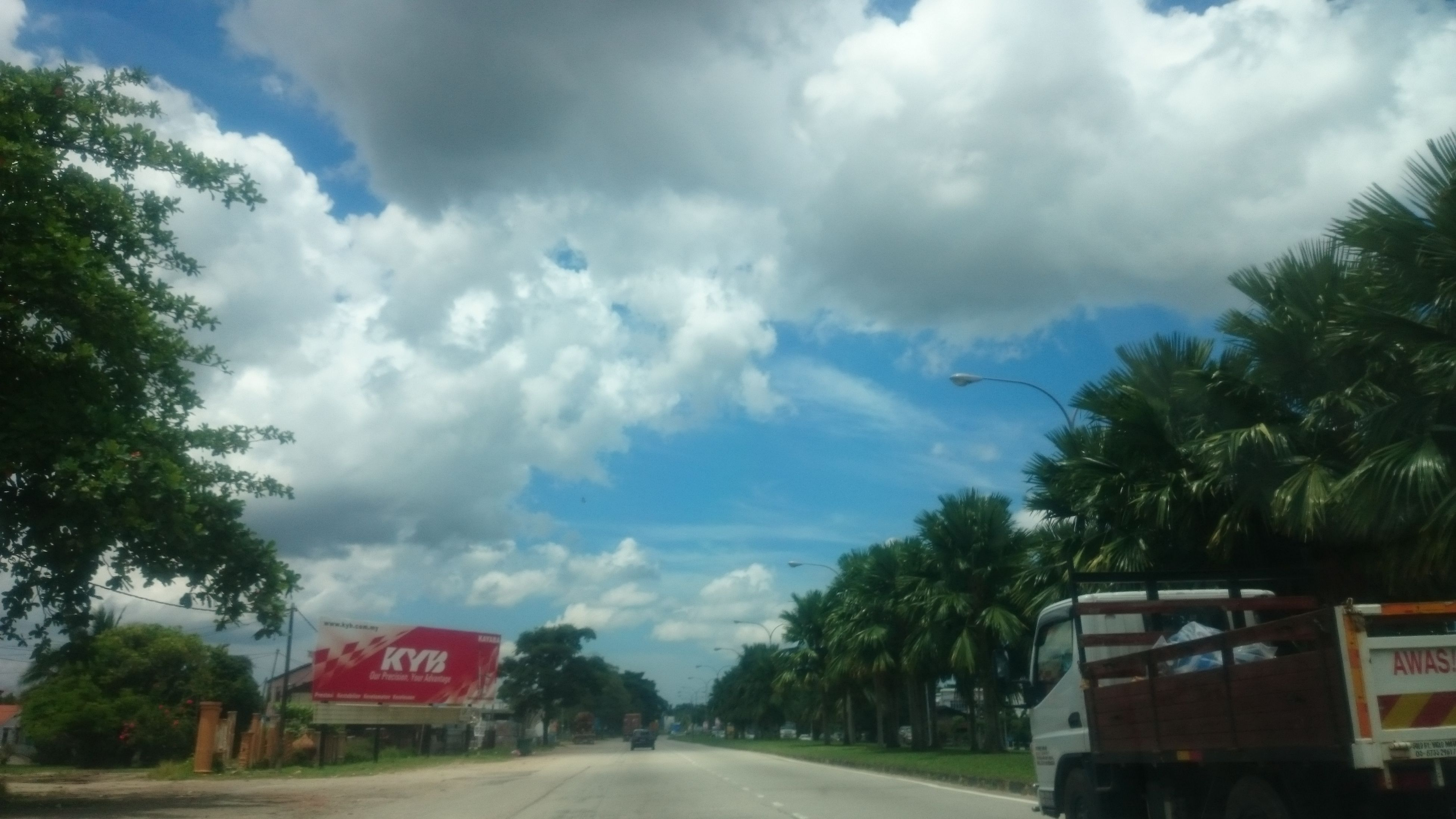 cloud - sky, sky, transportation, tree, mode of transport, land vehicle, no people, road, outdoors, day, nature, storm cloud