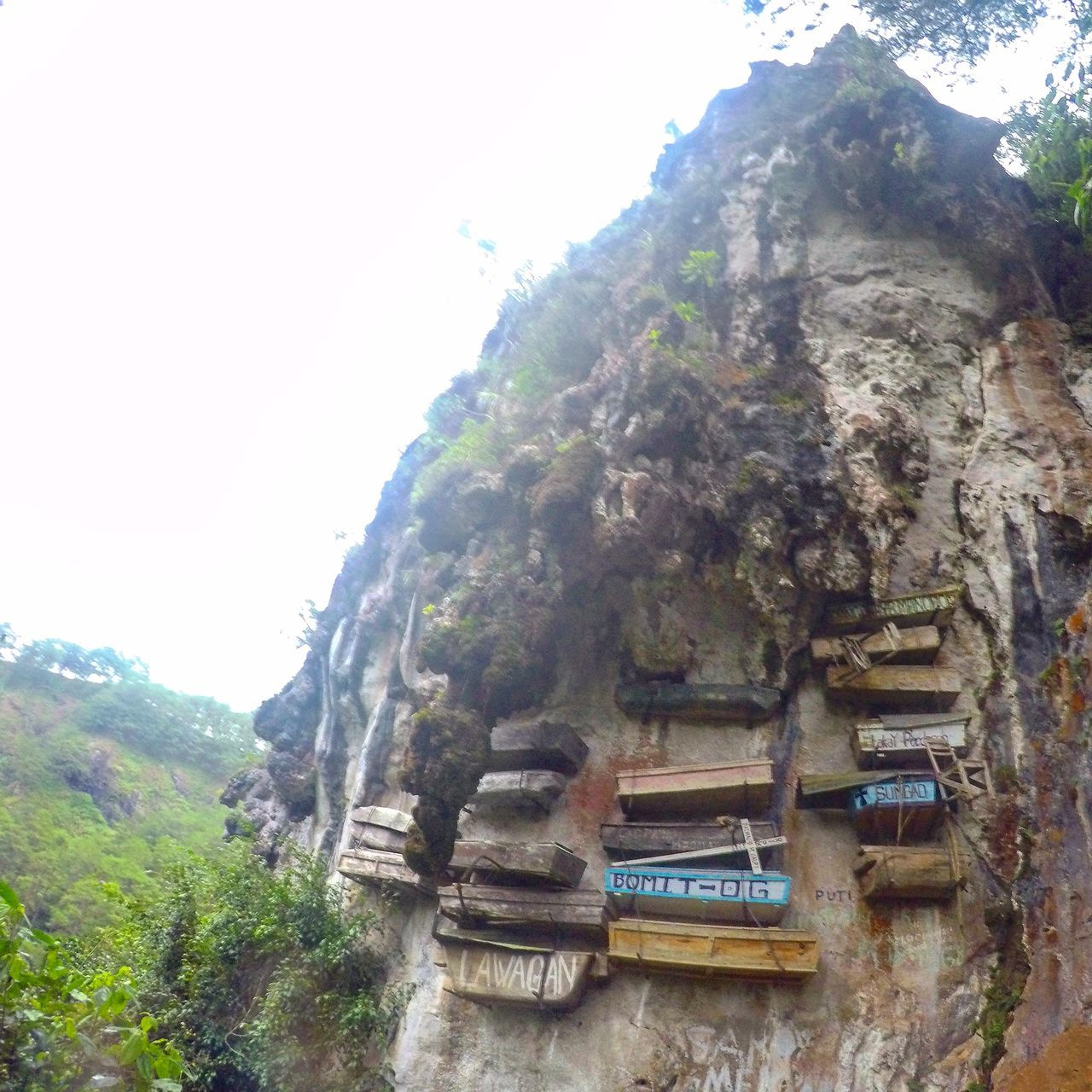 The Hangging Coffins of Sagada, Mt. Province Philippines New Talent EyeEmNewHere First Eyeem Photo Eyeem Philippines Travel Travel Photography GoPro Hero 4 GoPrography No People Vacations Travel Destinations Landscape Outdoors Tree Day Nature Plant SkyBeauty In Nature Mountain Cultures Scenics Rock Rock Formation