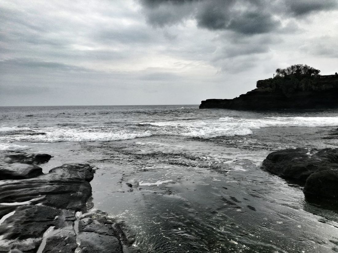 Sea Beach Nature Cloud - Sky Sand Landscape Horizon Over Water Scenics Beauty In Nature Water Travel Destinations Sky No People Outdoors Day Tanah Lot Rock - Object EyeEm Selects Tropical Climate Extreme Weather Vacations Nature Bali Shore Pacific Islands