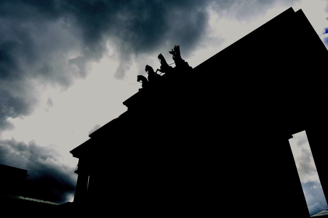 architecture, built structure, cloud - sky, silhouette, low angle view, sky, building exterior, statue, outdoors, sculpture, day, no people