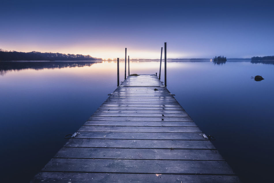 """""""Blue"""". Beauty In Nature Bridge Clear Sky Day Lake Nature No People Outdoors Reflection Scenics Sky Sunset Tranquil Scene Tranquility Water Zen-like Landscape"""