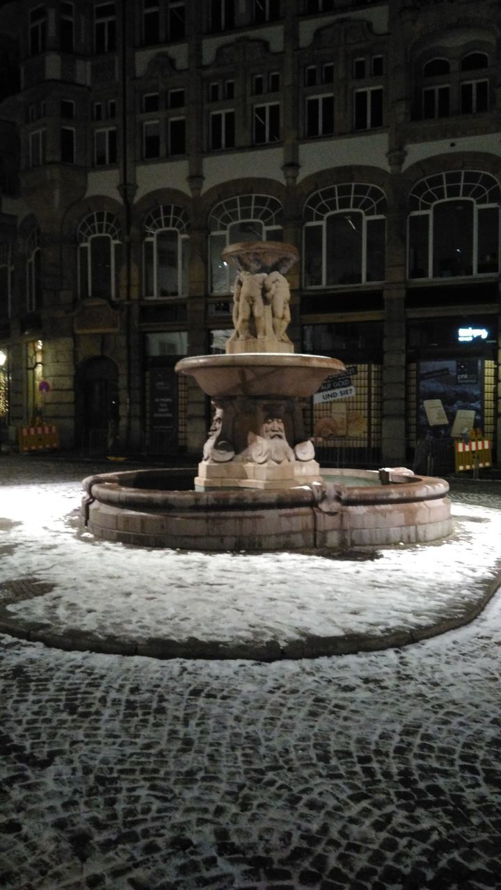 travel destinations, architecture, city, tourism, statue, fountain, built structure, sculpture, building exterior, snow, outdoors, no people, cold temperature, night, water, representing, sky