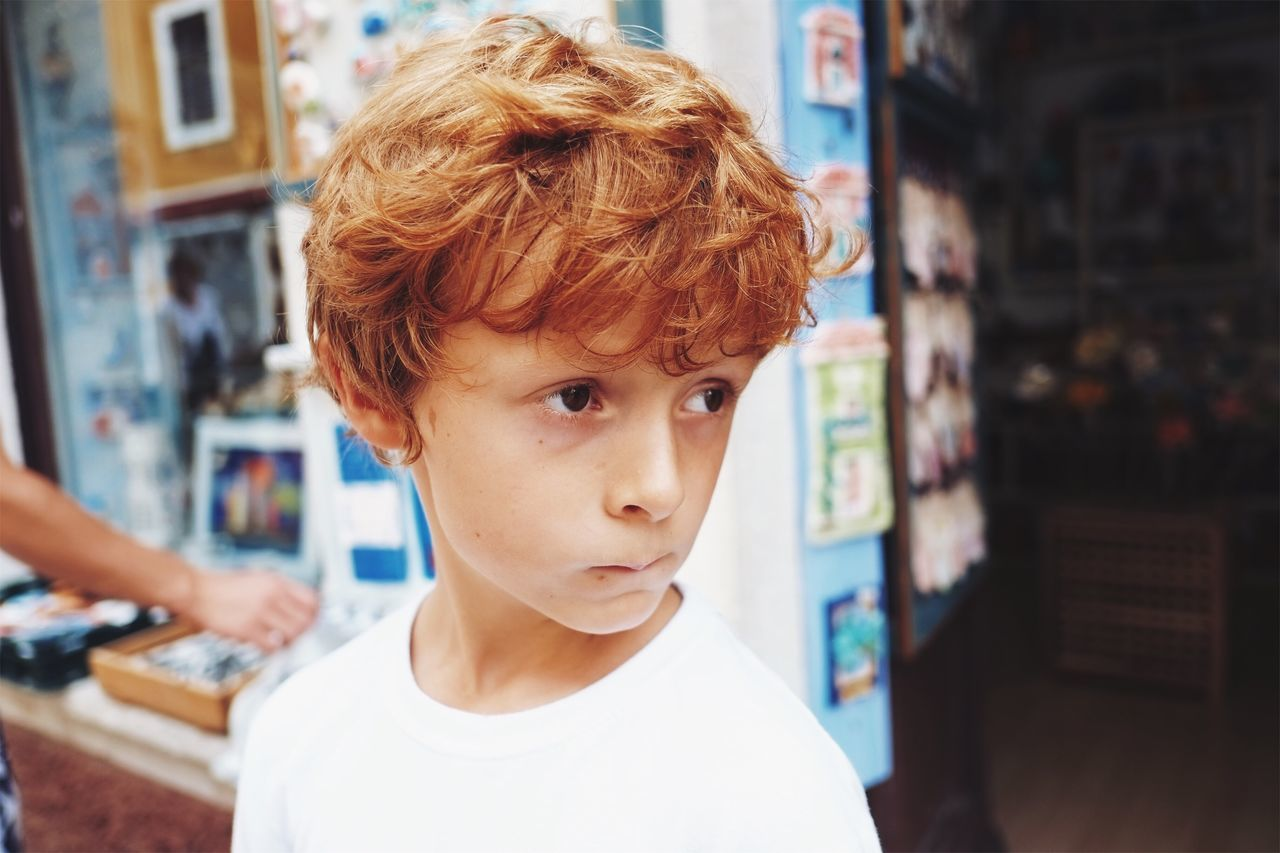 Boy in a gift shop. One Person Real People Childhood Focus On Foreground Boys Looking At Camera Portrait Day Architecture Building Exterior Outdoors Close-up People Giftshop