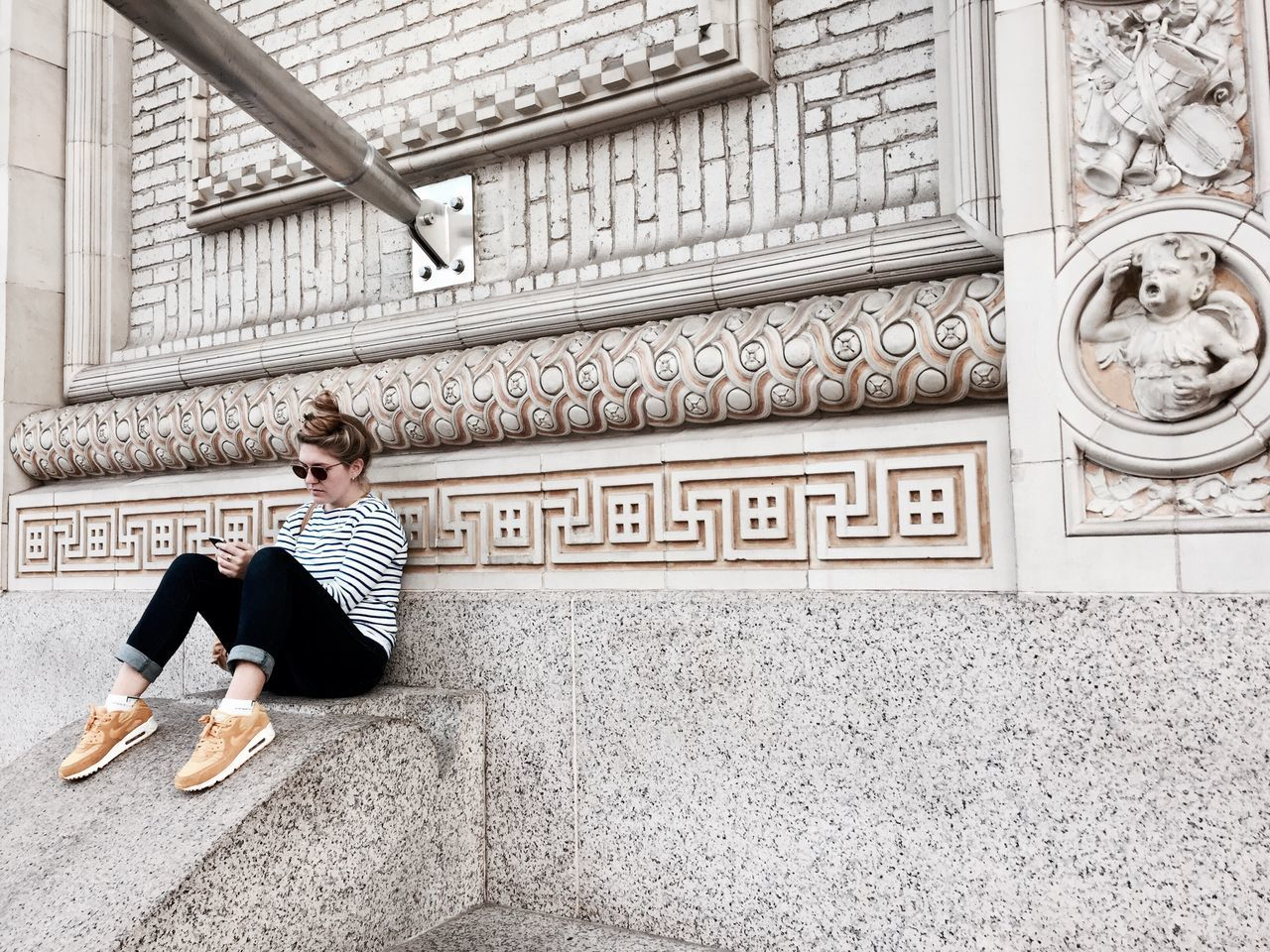 full length, sitting, steps, built structure, young adult, one person, women, lifestyles, architecture, young women, adult, day, building exterior, blond hair, people, beauty, outdoors, only women, adults only, one woman only
