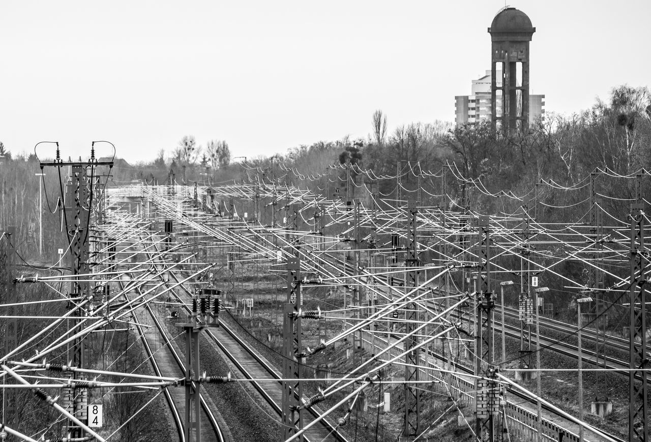 Berlin Photography Berliner Ansichten Black & White Black And White Cables Clear Sky Complex Complexity Confusion Day Electricity Pylon Gleise Logistic Metal No People Outdoors Rails Railway Railway Track Schienen Schöneberg Sky Transportation Urban Exploration Water Tower