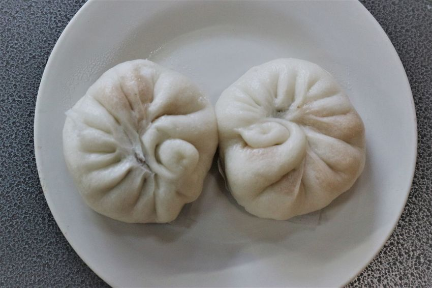 Yummy hot Chinese dumpling on dish ready to serve Breakfast Couple Discover Your City Hot Meal Chinese Dumpling Chinese Food Close-up Dim Sum Dumpling  Food Food And Drink Freshness Healthy Eating Indoors  Indulgence Plate Ready-to-eat Serving Size Steamed  Stuffed Two White Yummy