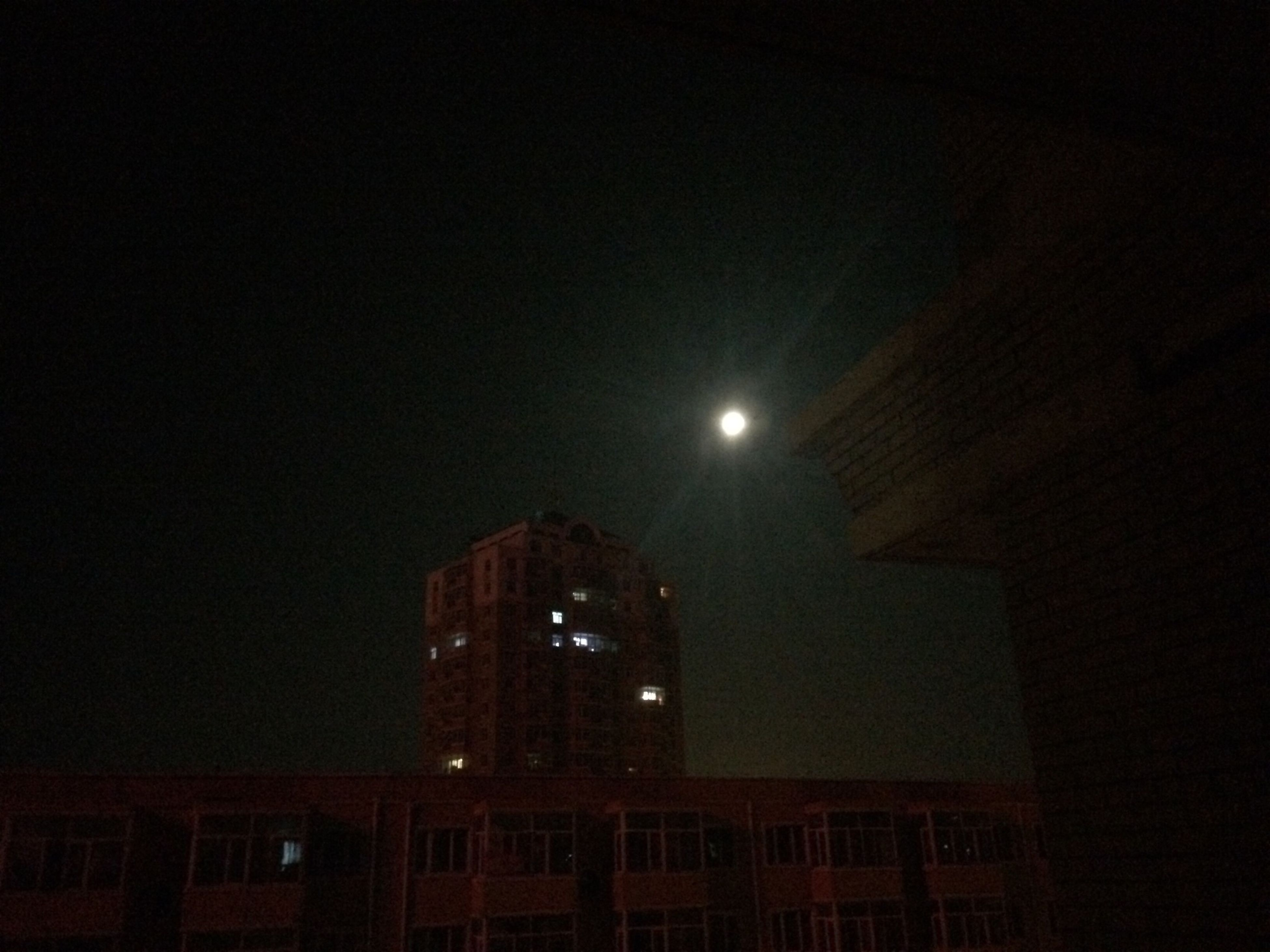 night, architecture, illuminated, building exterior, built structure, city, low angle view, sky, building, lighting equipment, moon, copy space, clear sky, modern, street light, residential building, tall - high, skyscraper, tower, office building