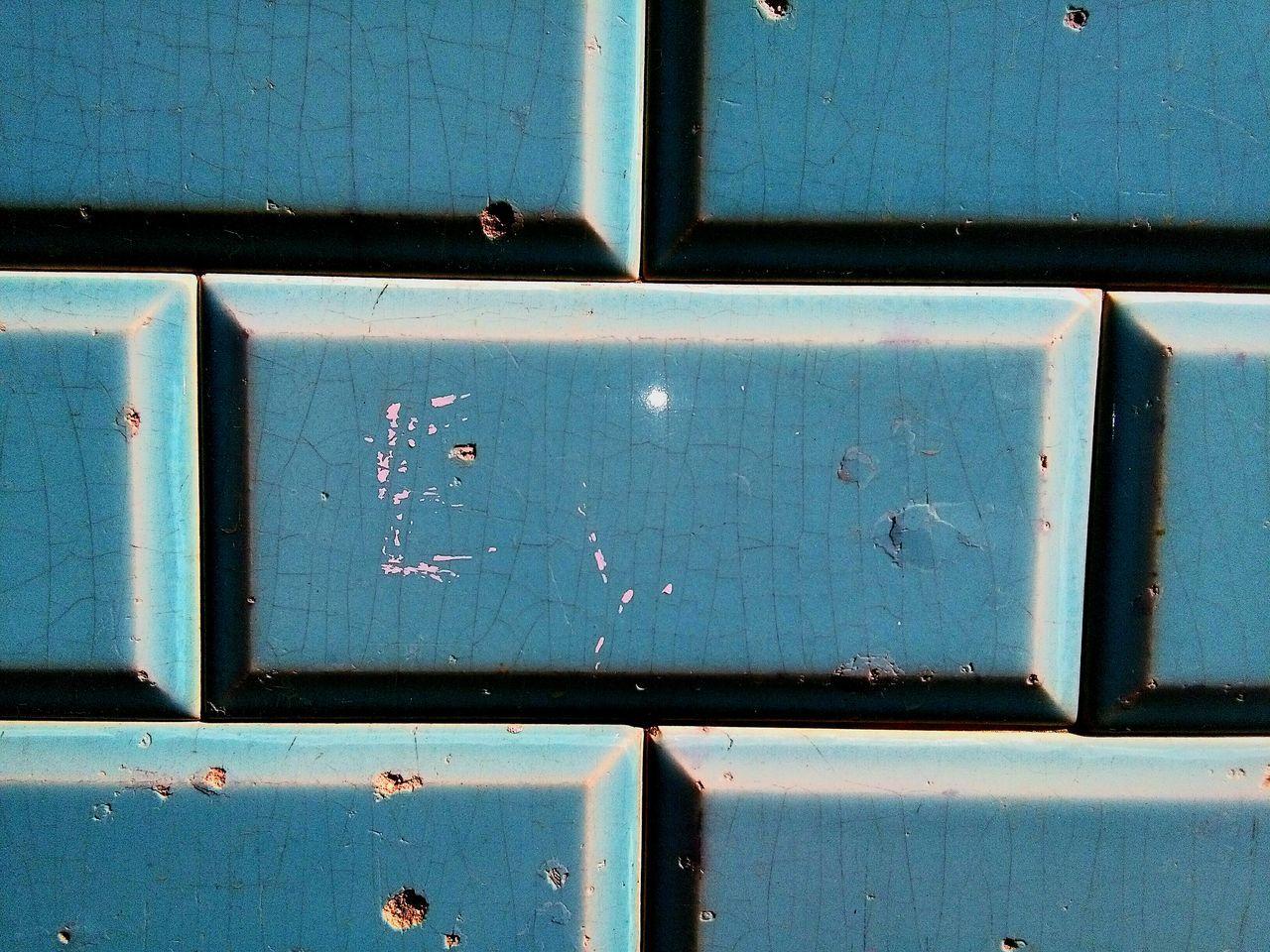 Full Frame Shot Of Blue Brick Wall