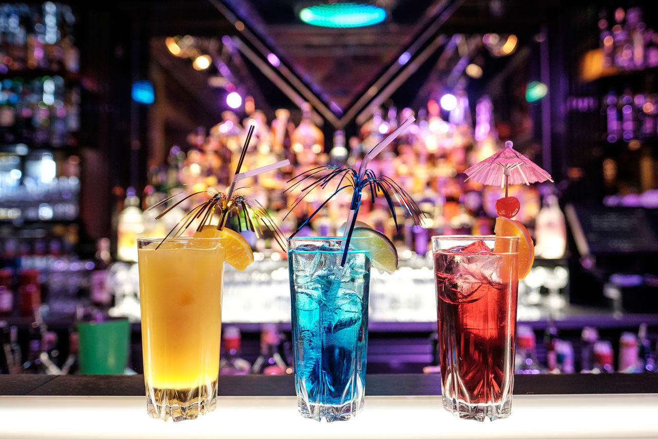 Three colourful cocktails on illuminated bar background Alcohol Bar - Drink Establishment Blackandwhite Bokeh Bokeh Photography Bokehlicious Close-up Cocktail Cocktail Bar Cocktails Drink Drinking Glass Drinking Straw Fancy Fancy Dress Focus On Foreground Food And Drink Fruits Lights Multi Colored Nightclub No People Refreshment Straw Yellow