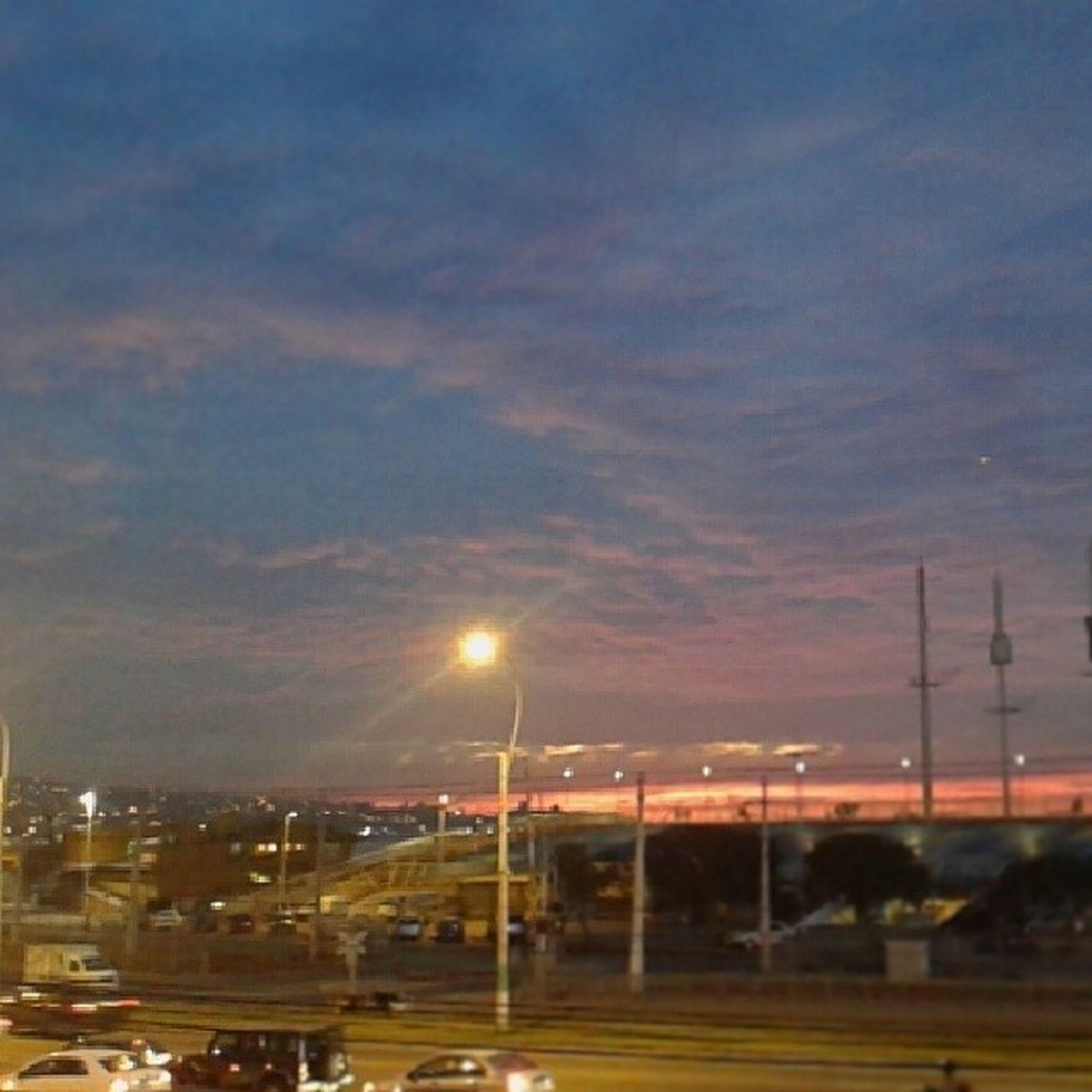 sky, illuminated, street light, cloud - sky, night, lighting equipment, cloudy, sunset, dusk, transportation, road, cloud, outdoors, dramatic sky, weather, nature, street, car, silhouette, no people