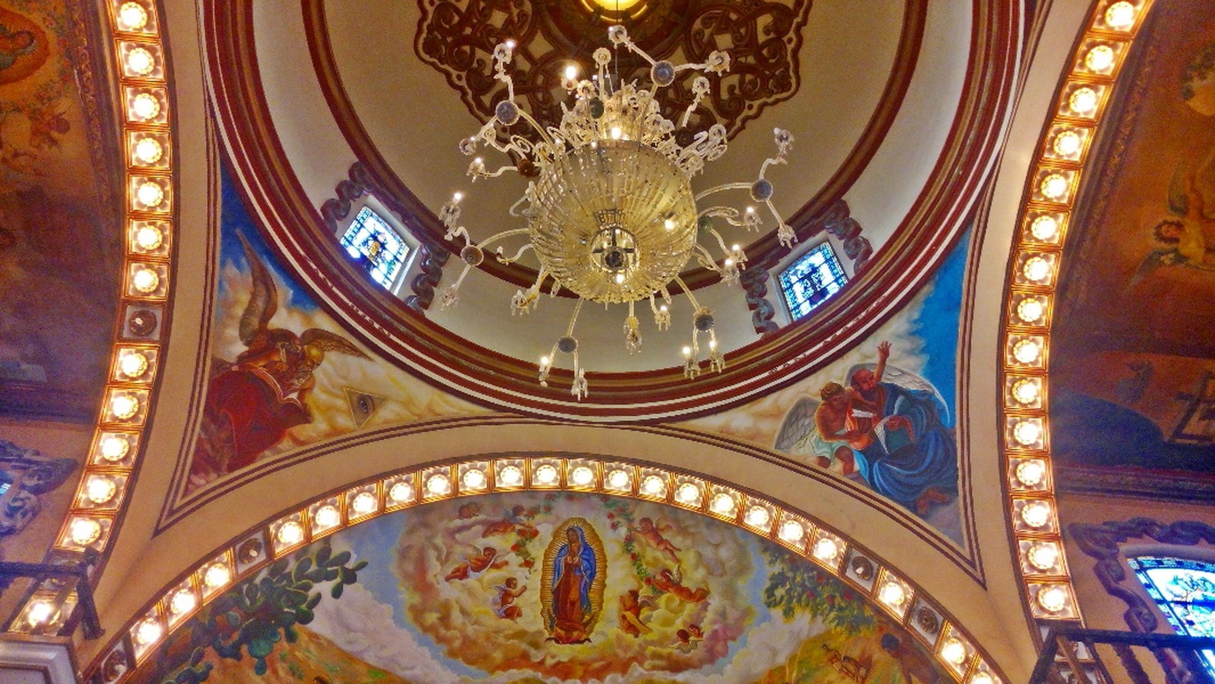 indoors, religion, ornate, place of worship, spirituality, art and craft, famous place, art, architecture, travel destinations, ceiling, creativity, design, tourism, built structure, international landmark, low angle view, carving - craft product, travel