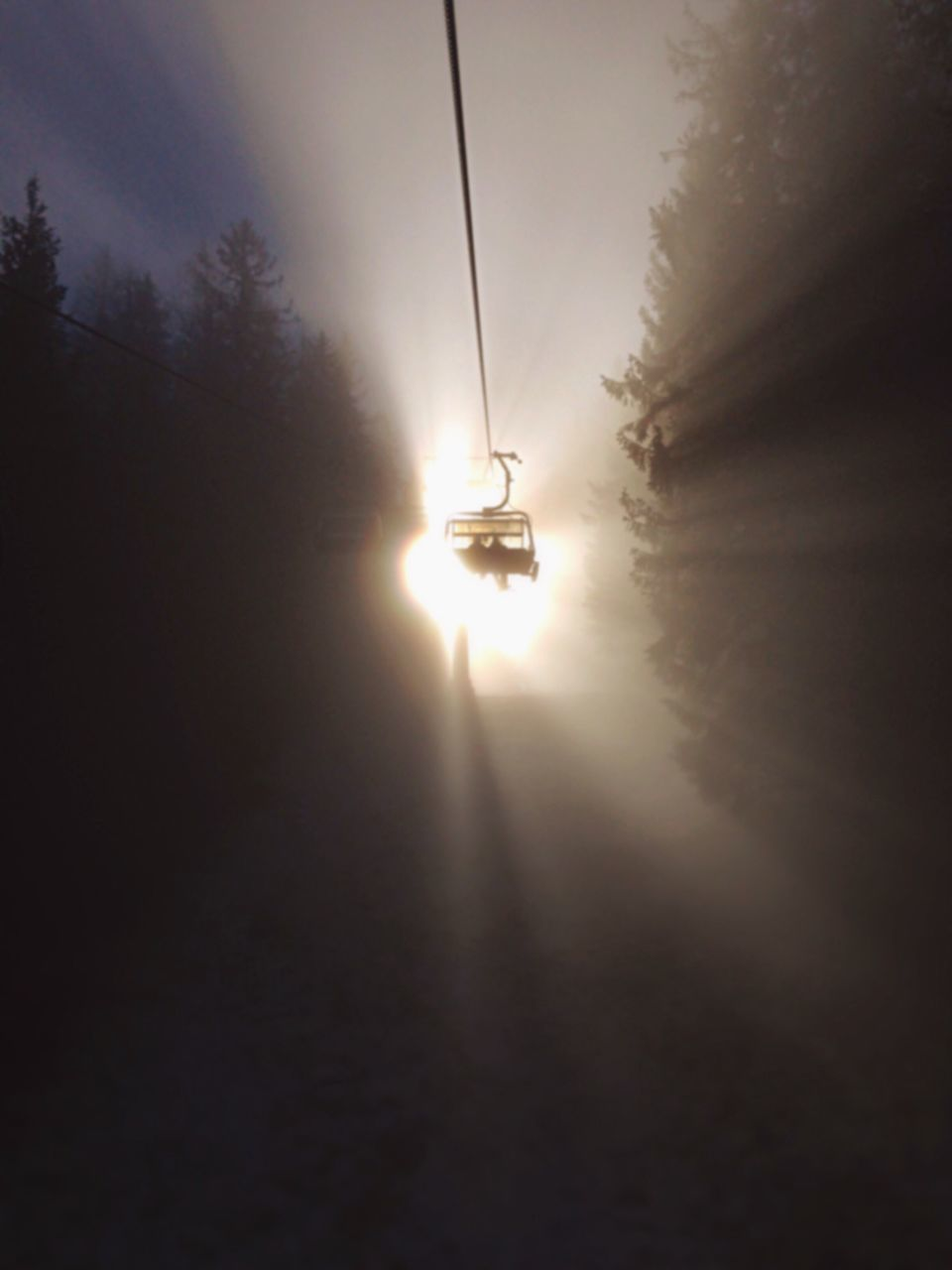 sunset, transportation, silhouette, mode of transport, sun, sky, hanging, nature, tree, fog, overhead cable car, no people, outdoors, nautical vessel, day, ski lift