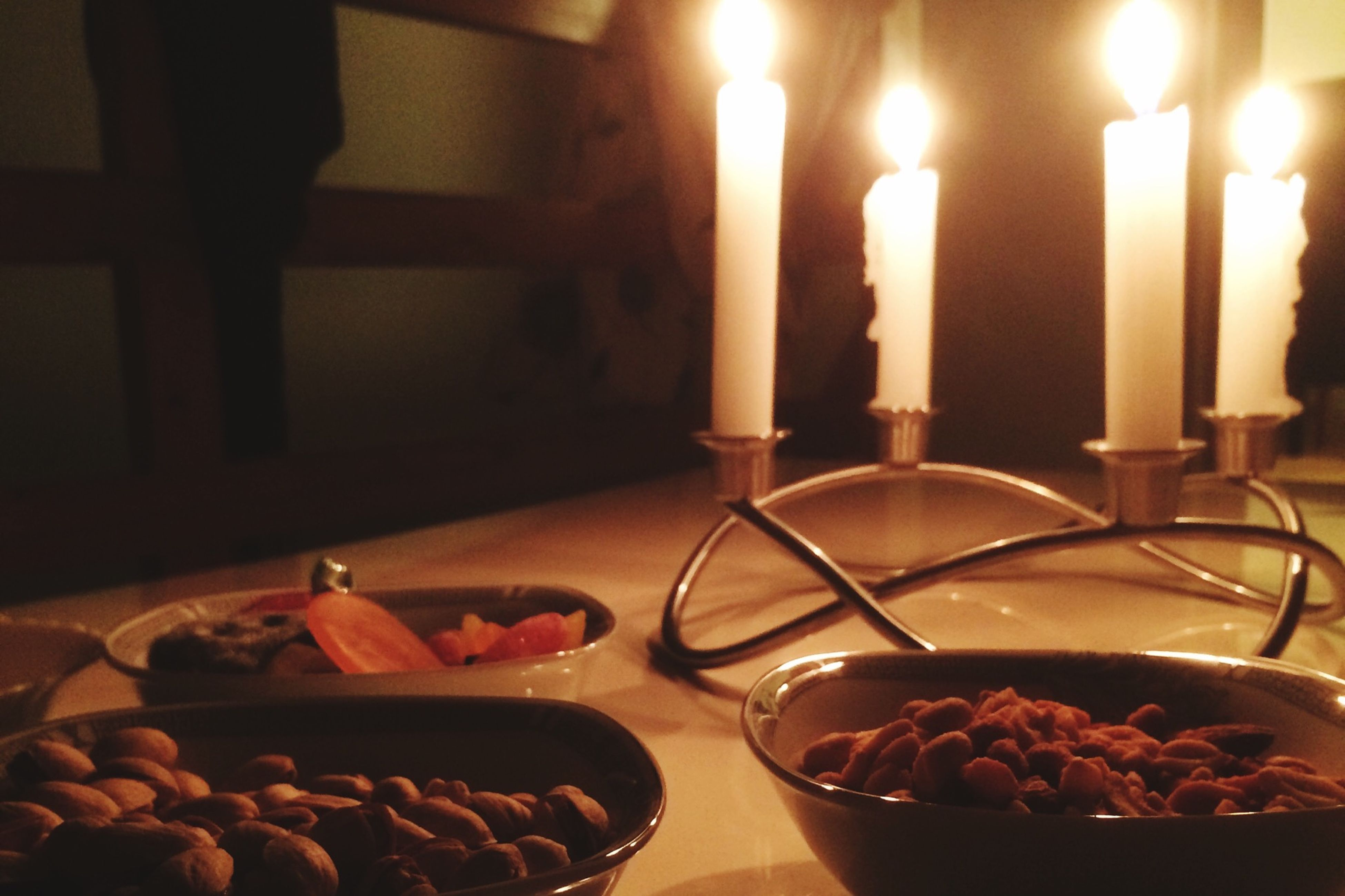 indoors, food and drink, food, table, still life, flame, burning, candle, freshness, heat - temperature, ready-to-eat, illuminated, plate, close-up, restaurant, drinking glass, indulgence, healthy eating, fire - natural phenomenon, lit