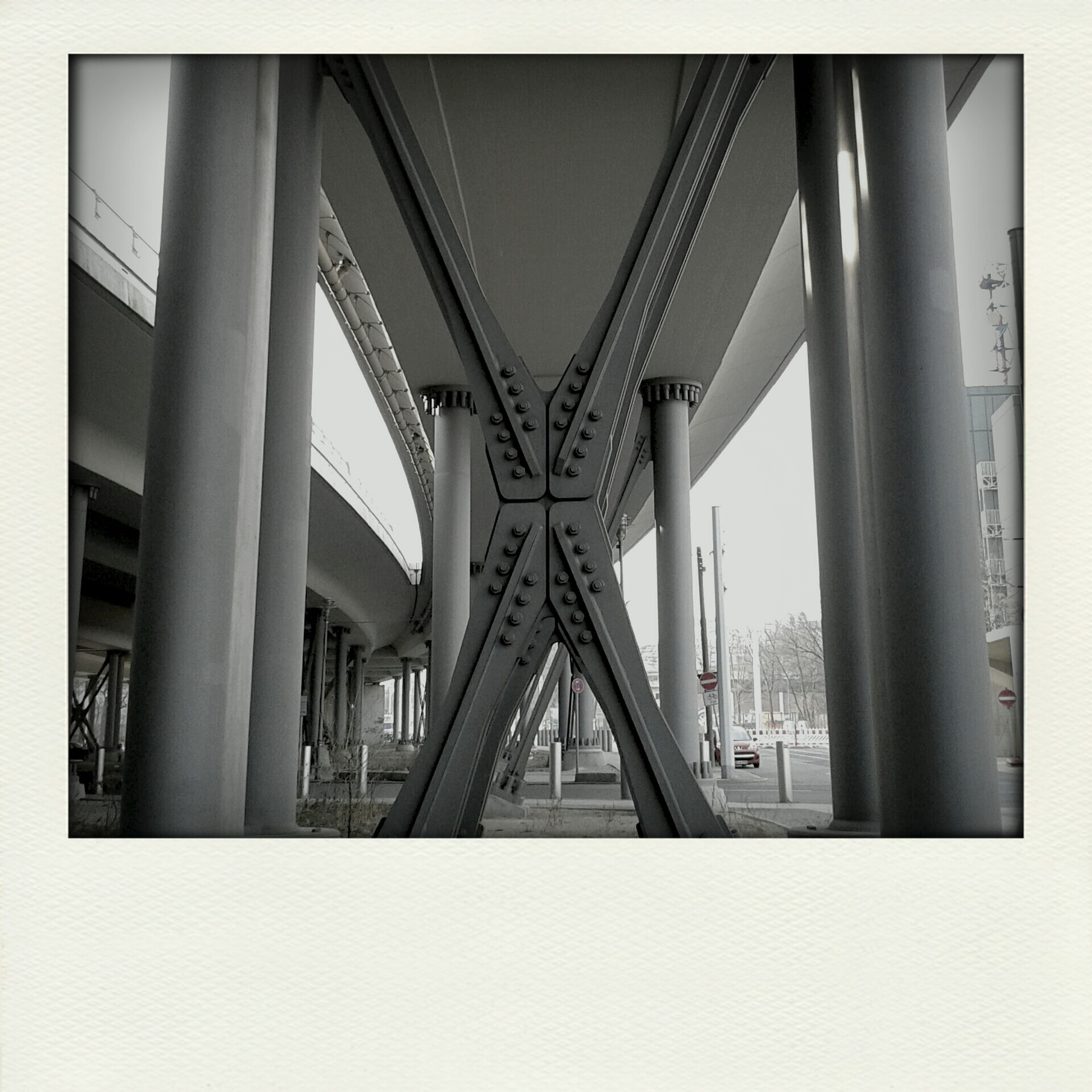 transfer print, architecture, built structure, bridge - man made structure, connection, auto post production filter, engineering, bridge, transportation, architectural column, sky, low angle view, building exterior, city, indoors, support, suspension bridge, day, no people, column
