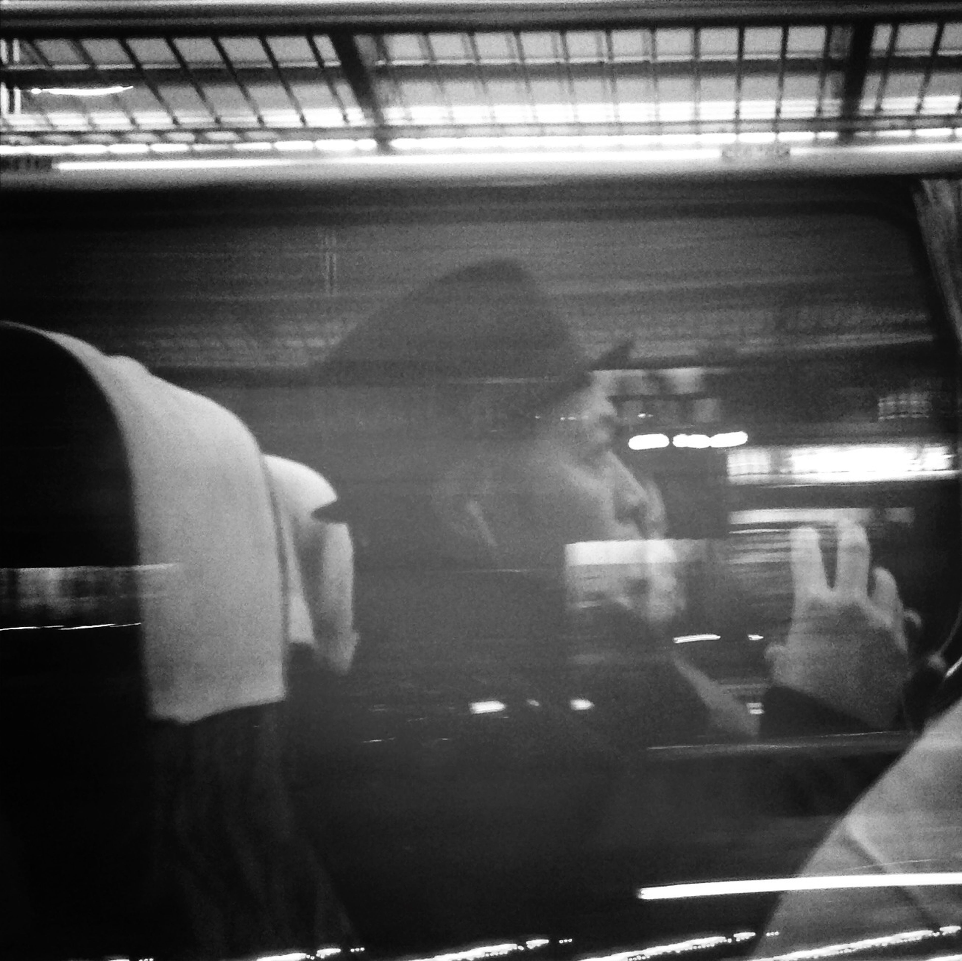 indoors, lifestyles, men, person, leisure activity, glass - material, transparent, public transportation, window, reflection, unrecognizable person, part of, high angle view, escalator, sitting