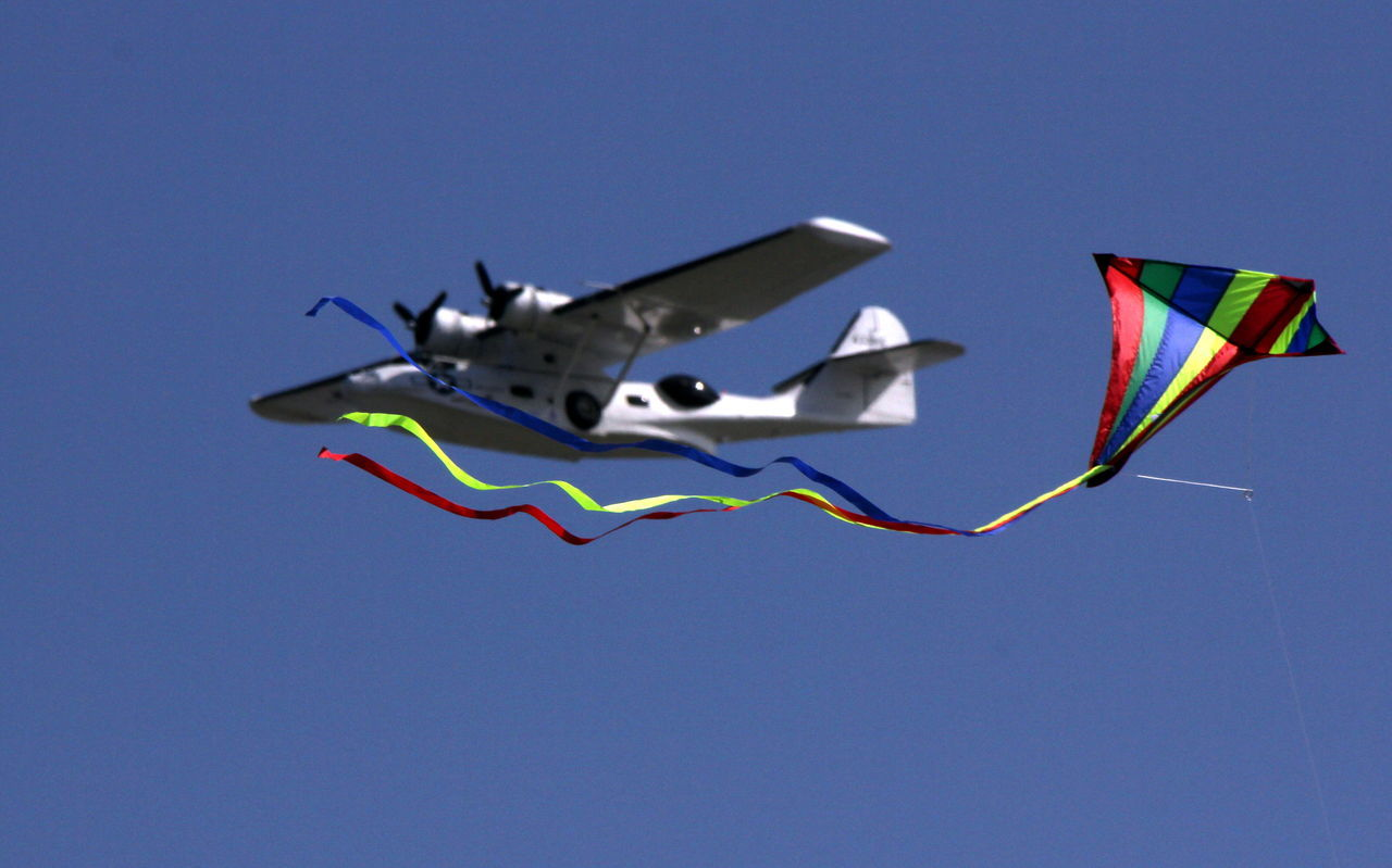 Blue Clear Sky Day Flag Flying Kite Kite Kite - Toy Low Angle View No People Outdoors Seaplane Sky Summer Sky  USAF Flying A Kite Aeroplane In The Sky Aeroplane Rescue Plane