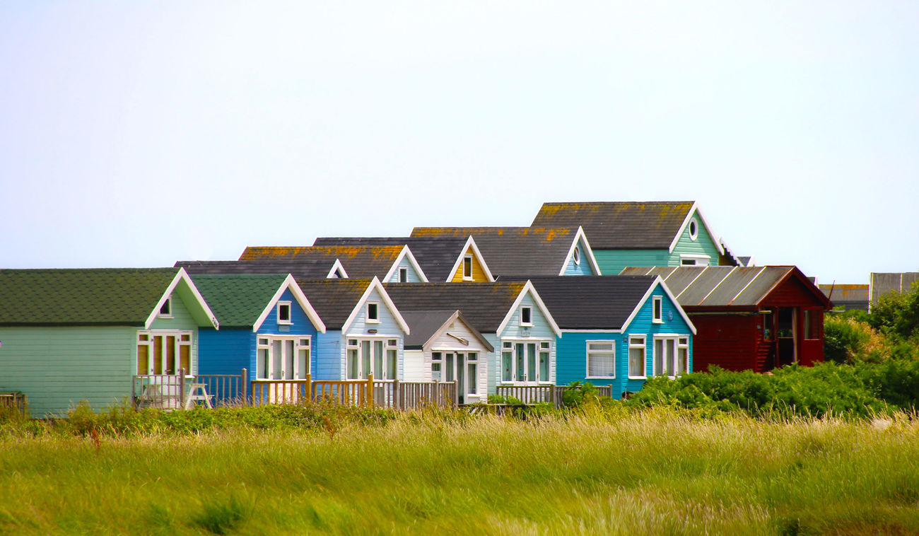 Beach Huts at Hengistbury Head Architecture Building Exterior Built Structure Clear Sky Day Grass House Landscape Nature No People Outdoors Sky