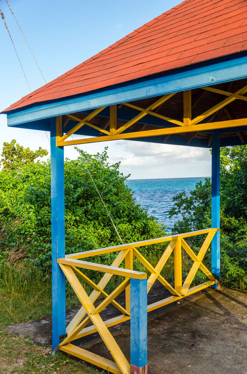 Colorful pavillion overlooking the Caribbean sea in San Andres y Providencia, Colombia Architecture Bay Beach Beautiful Building Calm Caribbean Coast Colombia Holiday Hot Idyllic Island Kiosk Landscape Nature Ocean Outdoors Paradise Providencia Resort SanAndres Sand Scenery Sea