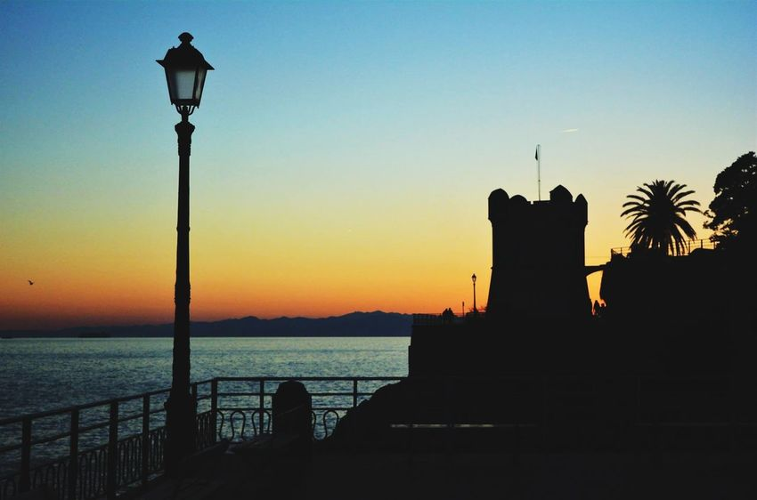 Sunset Silhouette History Travel Destinations No People Night Water Sea Sky Outdoors Nature Italy