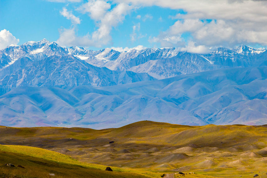 Kyrgyzstan Pamir Mountains Beauty In Nature Cloud - Sky Cold Temperature Day Landscape Mountain Mountain Range Nature No People Outdoors Pamir Scenics Sky Snow Tranquil Scene Tranquility Winter