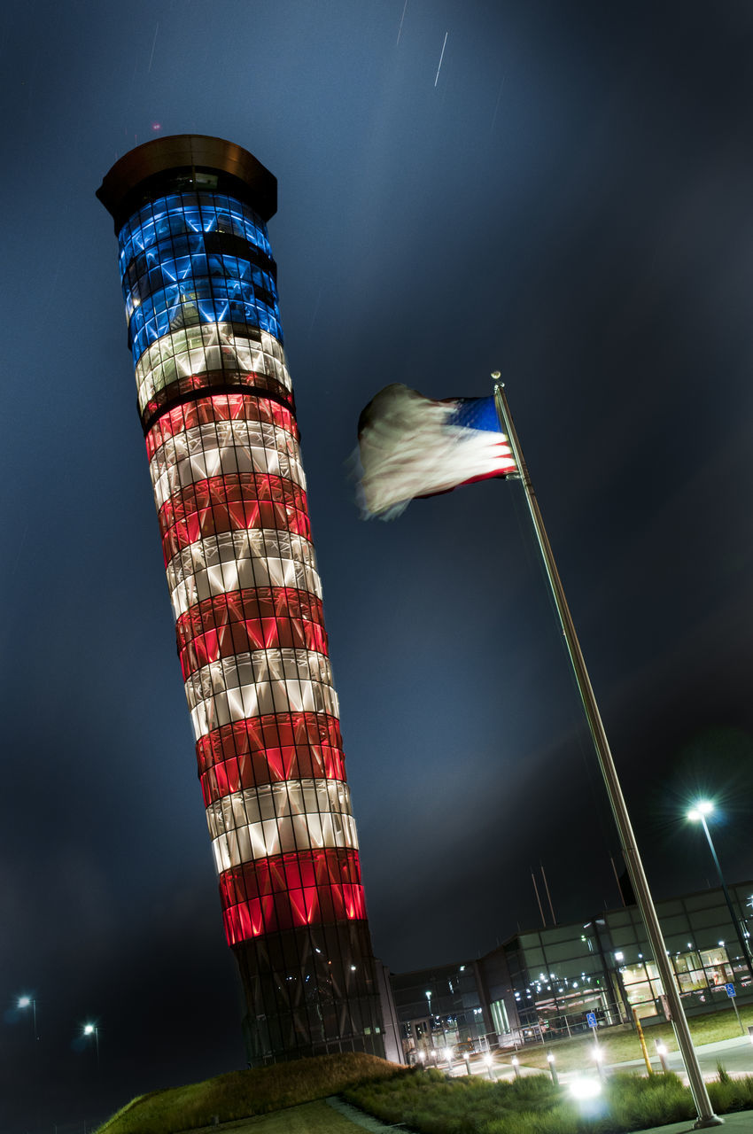 flag, night, patriotism, low angle view, red, no people, illuminated, building exterior, built structure, architecture, pride, sky, outdoors