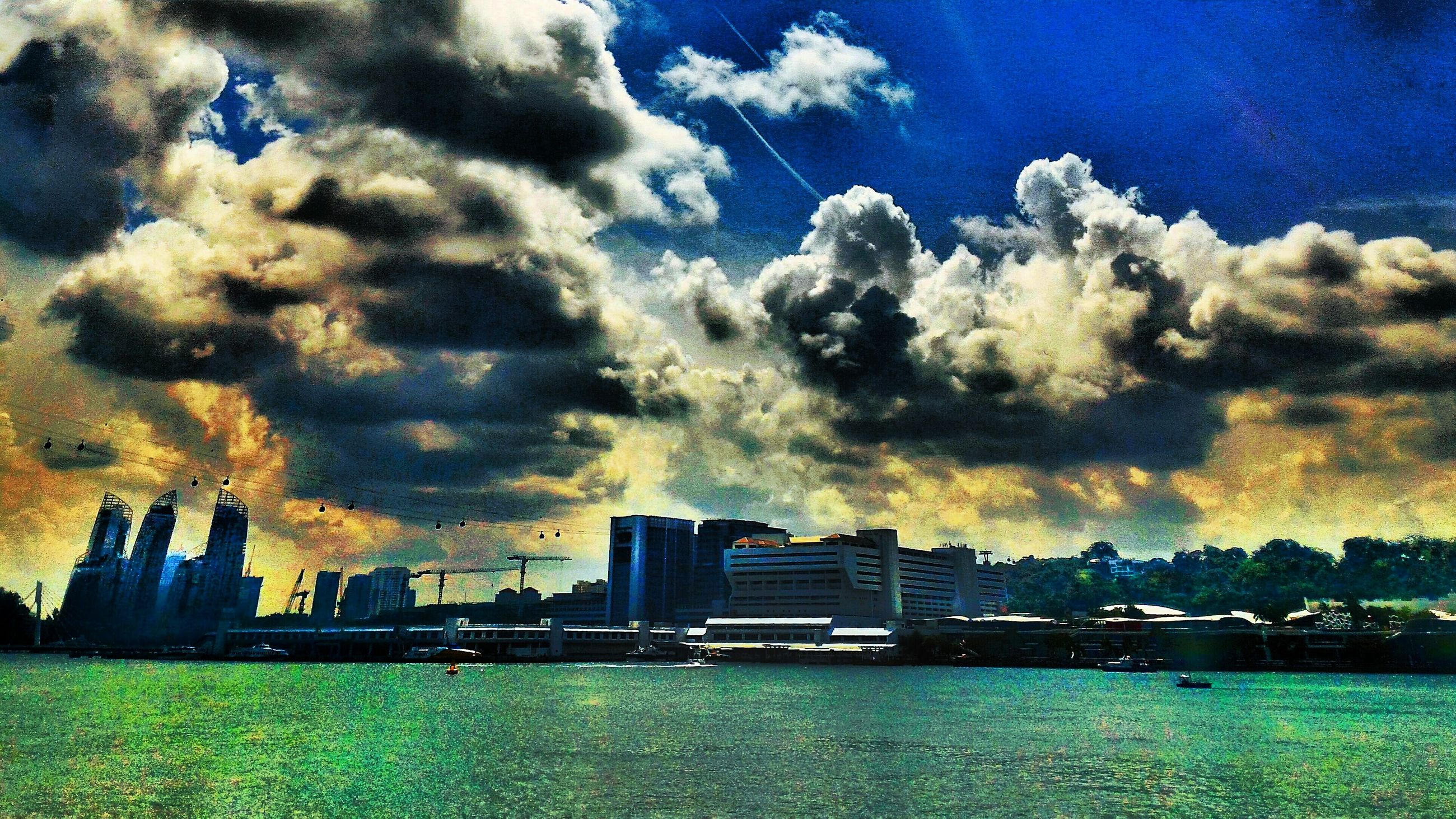 sky, water, building exterior, cloud - sky, architecture, built structure, blue, waterfront, cloudy, cloud, city, sea, nature, dusk, beauty in nature, silhouette, river, outdoors, scenics, dramatic sky