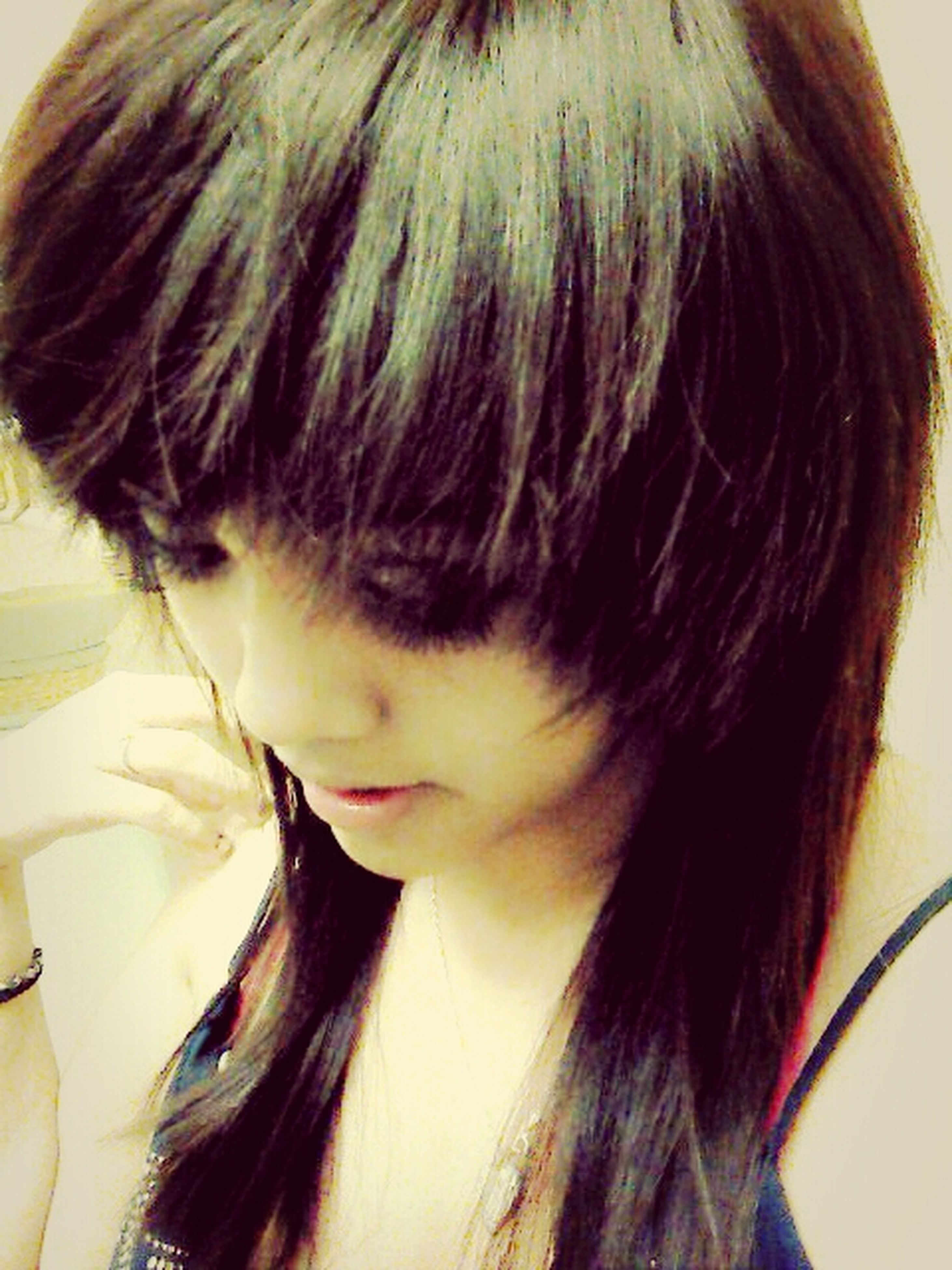 headshot, long hair, young adult, lifestyles, young women, close-up, person, human hair, indoors, leisure activity, human face, black hair, brown hair, head and shoulders, looking at camera, front view