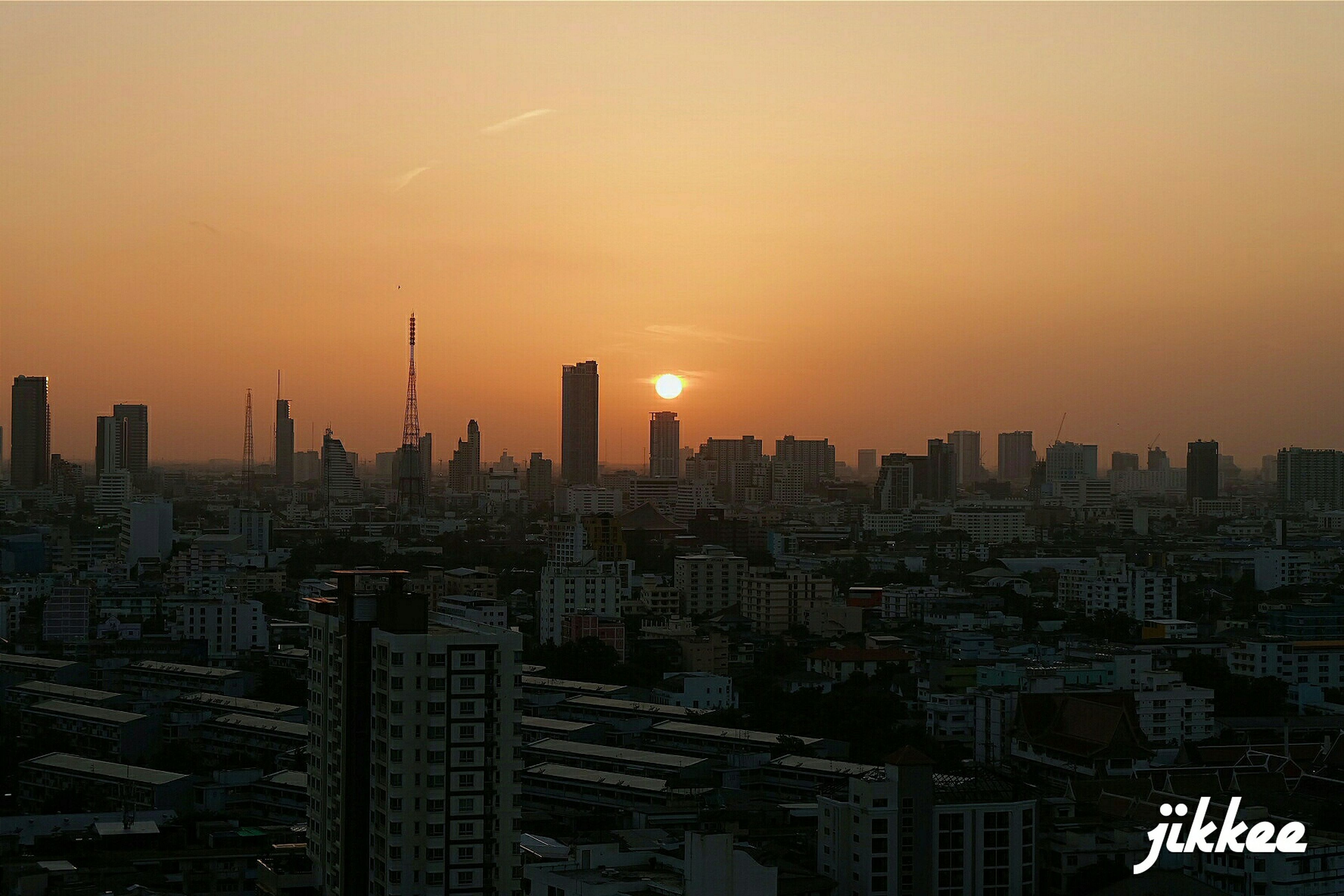 city, cityscape, building exterior, sunset, architecture, built structure, skyscraper, crowded, tower, tall - high, orange color, high angle view, sky, urban skyline, residential district, city life, office building, residential building, modern, illuminated