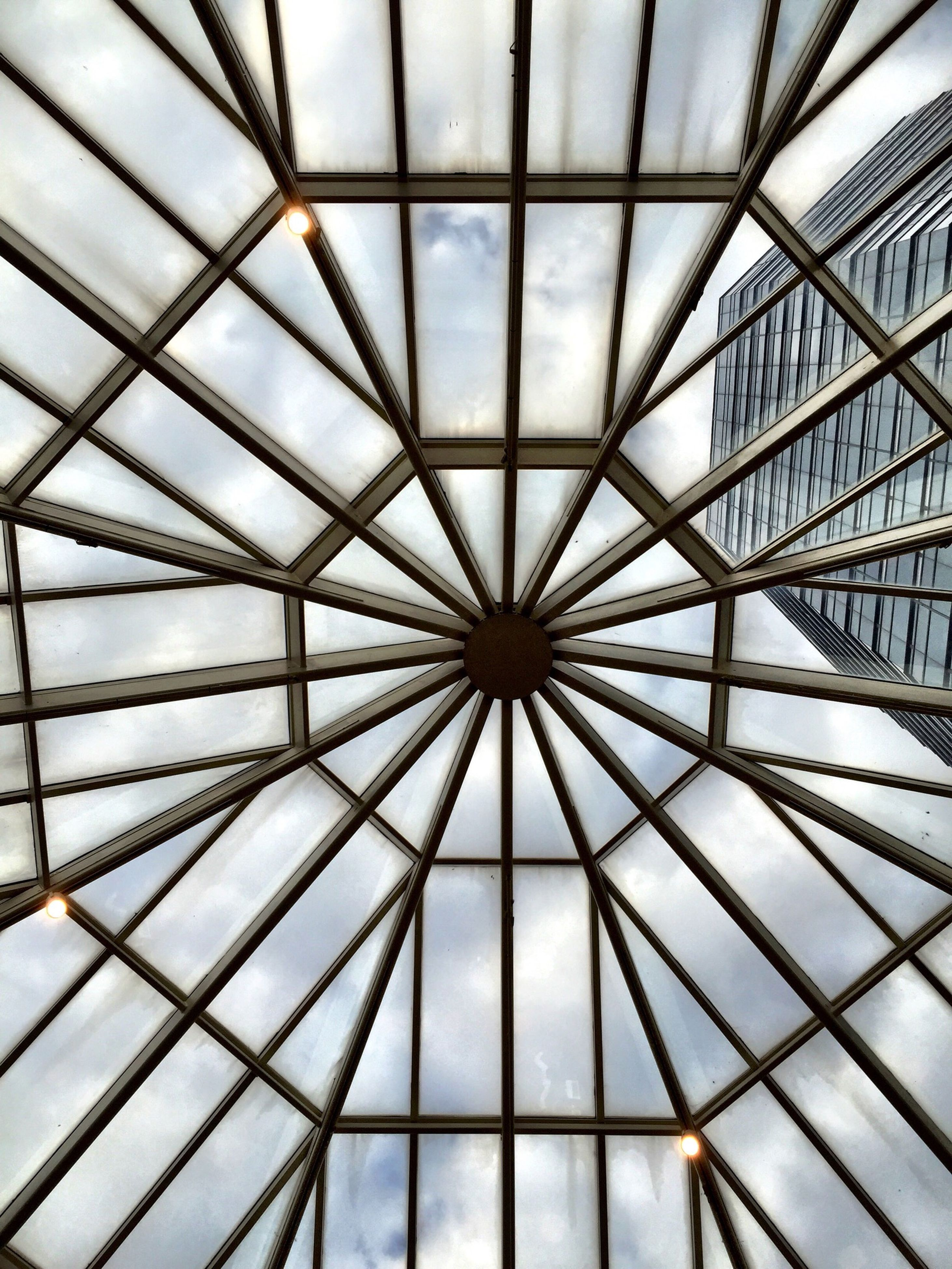 indoors, ceiling, pattern, architecture, low angle view, built structure, modern, directly below, design, full frame, geometric shape, architectural feature, skylight, glass - material, backgrounds, repetition, shape, no people, diminishing perspective, abstract