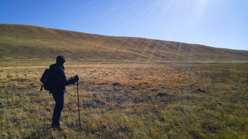 A Hill to Climb Backpacking Big Sky Climb Colorado EyeEmNewHere Grass Hiking Nature Reinecker Walking Stick Adventure Backpack Climbing Hiker Hill Landscape Leisure Activity One Man Only Outdoors Sunbeam Valley