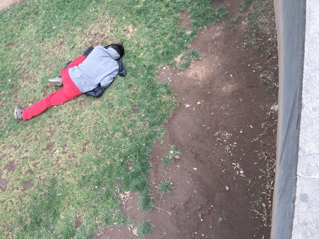 High Angle View Full Length One Person Real People Day Grass Homeless Outdoors People Street Photography Poverty Poor People  Social Issues Human Condition Undeveloped Third World IPhone Streetphotography The Purist (no Edit, No Filter)